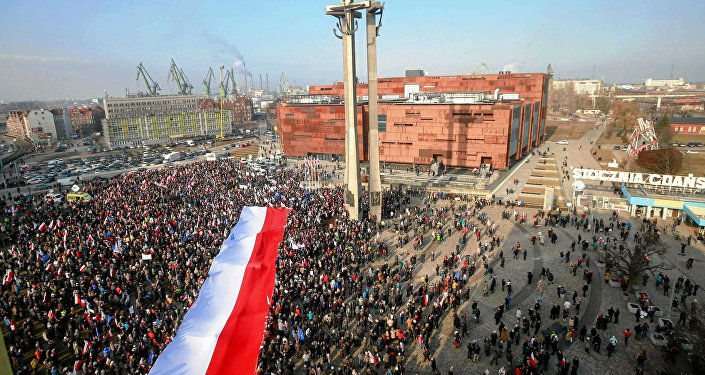 People hold Polish national flag during a demonstration in Gdansk, Poland February 28, 2016.