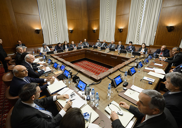 United Nations (UN) special envoy Staffan de Mistura (C-L) sits facing Syria's main opposition group during Syrian peace talks at the UN Offices in Geneva. (File)
