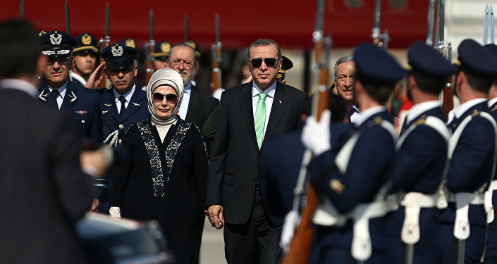 Turkish President Recep Tayyip Erdogan, right, and his wife, Emine, arrive at the airport in Santiago, Chile, Sunday, Jan. 31, 2016