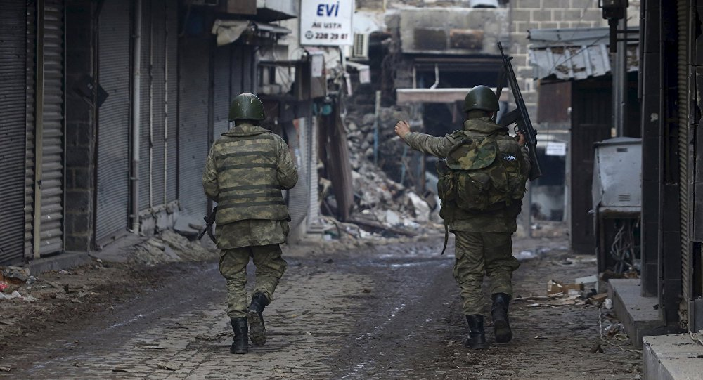 Turkish soldiers patrol in Sur district, which is partially under curfew, in the Kurdish-dominated southeastern city of Diyarbakir, Turkey February 26, 2016