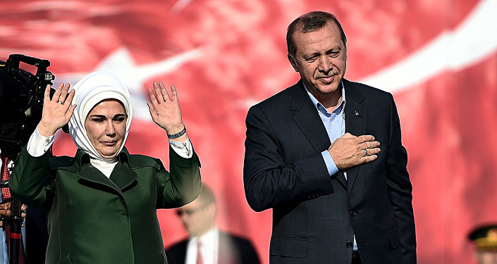 Turkish President Recep Tayyip Erdogan (R) and his wife Emine Erdogan (L) greet supporters during an antiterorrism rally in Istanbul on September 20, 2015