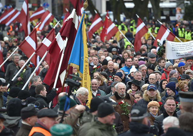 Veterans of the Latvian Legion, a force that was commanded by the German Nazi Waffen SS during WWII, and their sympathizers carry flowers as they walk to the Monument of Freedom in Riga, Latvia on March 16, 2016