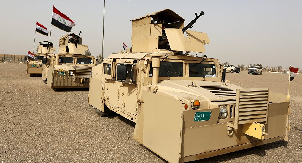 Iraqi security forces ride in vehicles travelling to Mosul to fight against militants of Islamic State at an Iraqi army base in Camp Taji in Baghdad, February 21, 2016