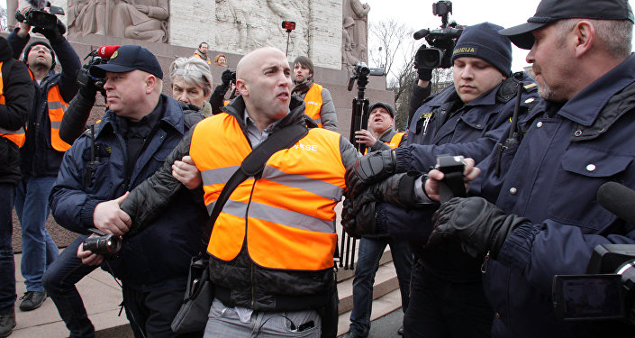 The arrest of journalist Graham Phillips at SS veterans' march in Riga, Latvia. March 16, 2016