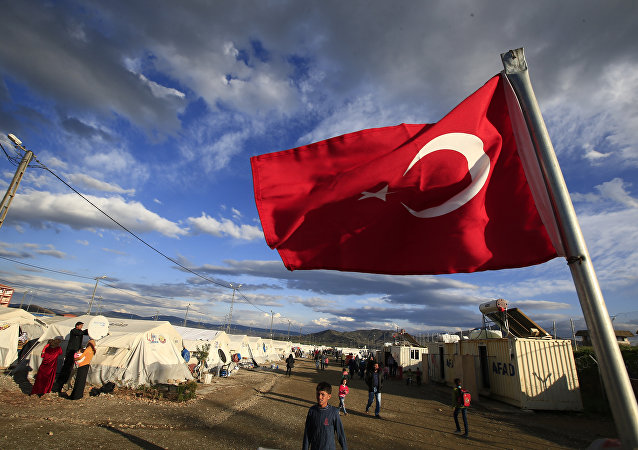 Turkish flag flies at the refugee camp for Syrian refugees in Islahiye, Gaziantep province, southeastern Turkey,Wednesday, March 16, 2016.
