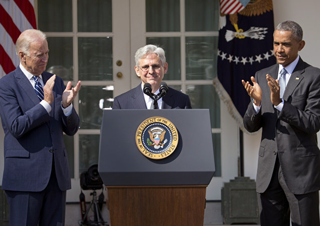 Federal appeals court judge Merrick Garland, receives applauds from President Barack Obama and Vice President Joe Biden as he is introduced as Obama's nominee for the Supreme Court during an announcement in the Rose Garden of the White House, in Washington, Wednesday, March 16, 2016
