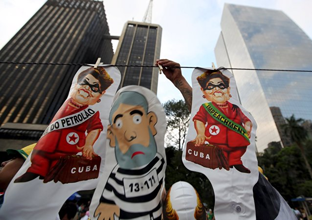 A vendor displays inflatable dolls of Brazilian President Dilma Rousseff and the 'Pixuleco' of Brazil's former President Luiz Inacio Lula da Silva during a protest against Rousseff's appointment of Lula da Silva as her chief of staff at Paulista avenue in Sao Paulo, Brazil, March 17, 2016.