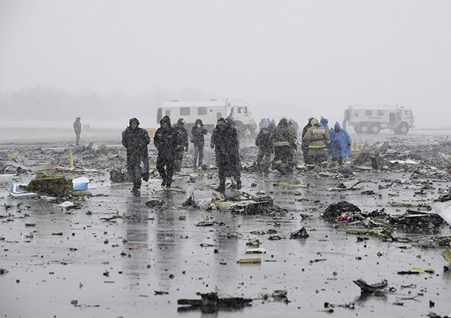 Investigators, members of Russia's Emergencies Ministry and other services work at the crash site of a Boeing 737-800 operated by Dubai-based budget carrier Flydubai, at the airport of Rostov-On-Don, Russia, March 19, 2016.