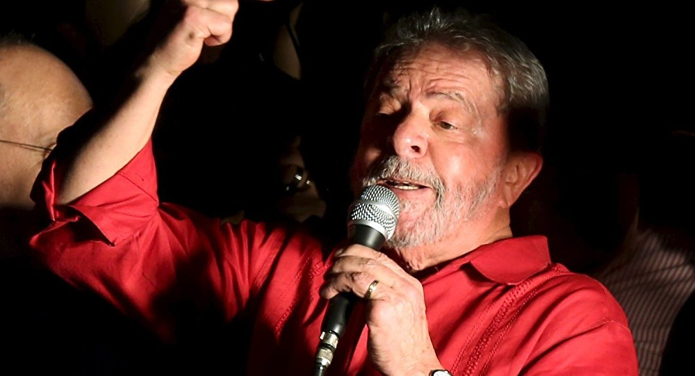 Brazilian President Luiz Inacio Lula da Silva gestures during a demonstration in support of Brazil's President Dilma Rousseff's appointment of him as her chief of staff, at Paulista avenue in Sao Paulo, Brazil
