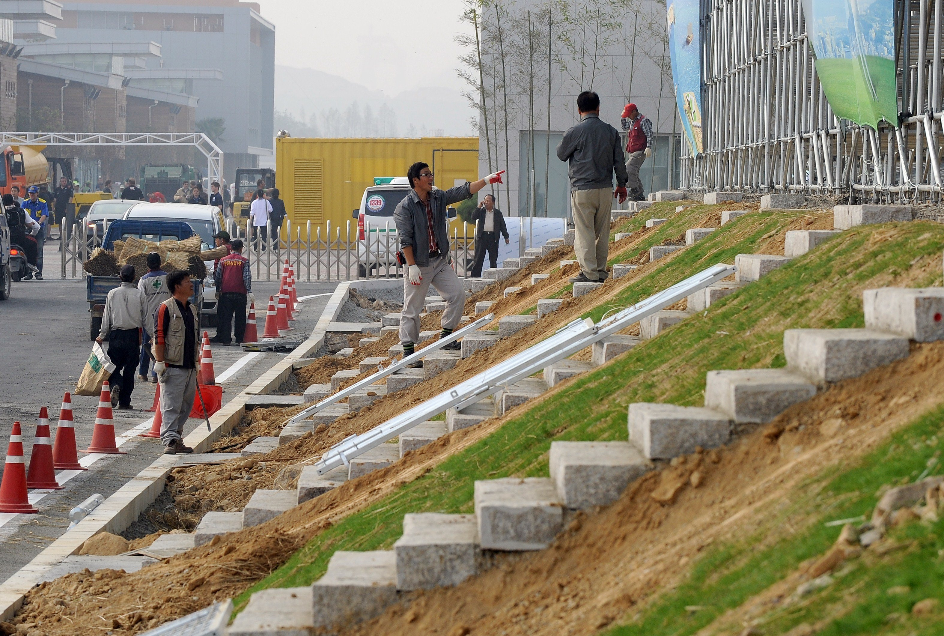 South Korean workers build stairs near the main grand stand at the Korean International Circuit under construction ahead Formula One's Korean Grand Prix in Yeongam, 320 km south of Seoul. (File)