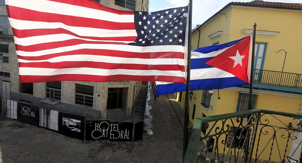 US and Cuban flags are seen on the balcony of a restaurant in downtown Havana, Cuba.