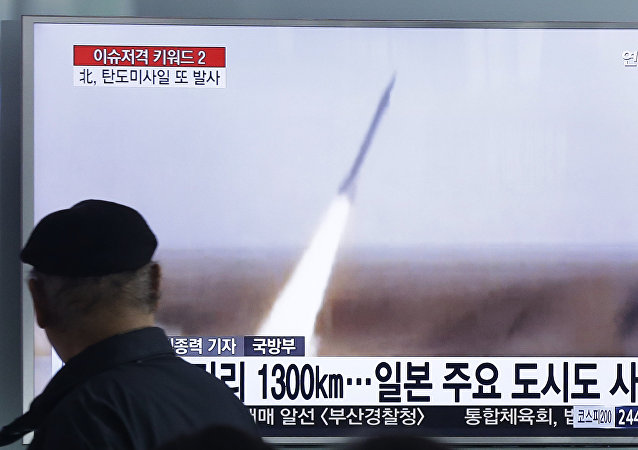 A man watches a TV screen showing a file footage of the missile launch conducted by North Korea, at Seoul Railway Station in Seoul, South Korea, Friday, March 18, 2016