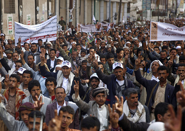 Shiite rebels, known as Houthis protest against Saudi-led airstrikes, in Sanaa, Yemen, Friday, March 18, 2016.