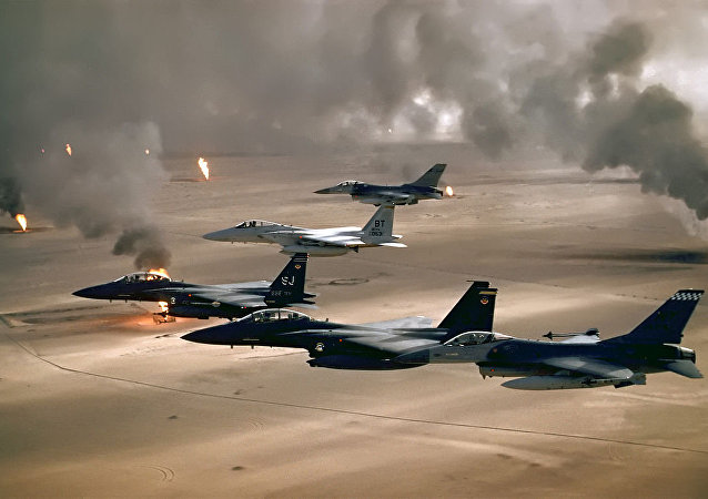 USAF aircraft of the 4th Fighter Wing (F-16, F-15C and F-15E) fly over Kuwaiti oil fires, set by the retreating Iraqi army during Operation Desert Storm in 1991