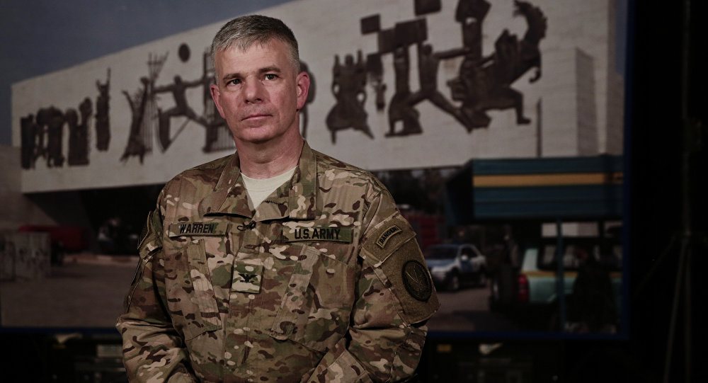 U.S. Army Col. Steve Warren, spokesman for the U.S.-led coalition against the Islamic State Group pauses during an interview with The Associated Press in Baghdad, Iraq, Thursday, March 10, 2016