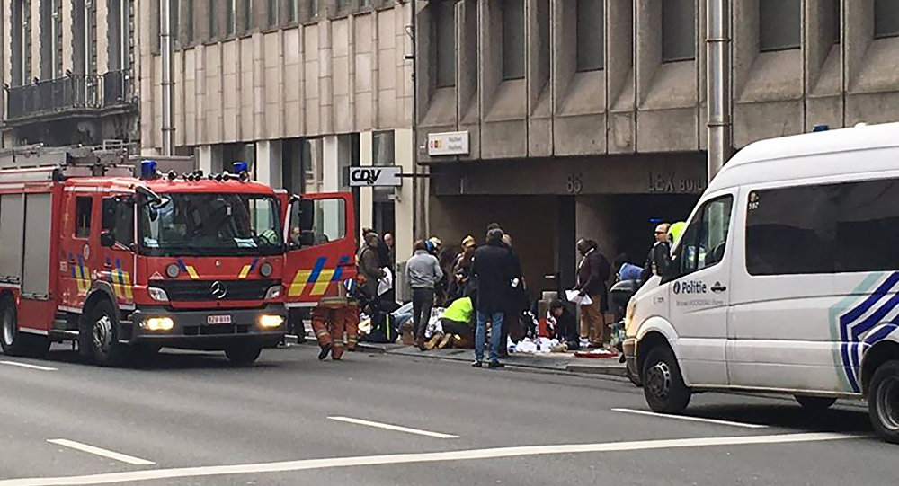 Emergency services take care of wounded people outside the Maalbeek metro station in Brussels on March 21, 2016 after a blast at this station located near the EU institutions