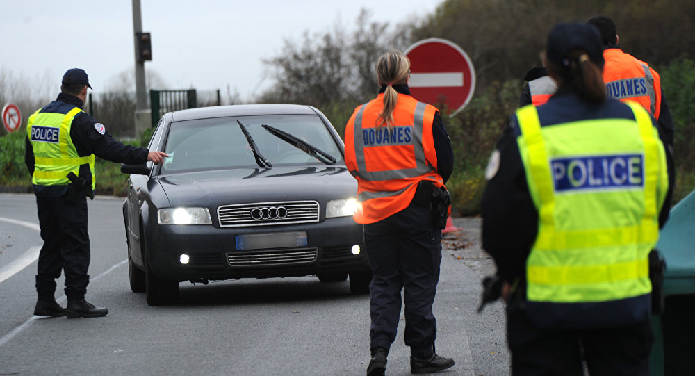 French border and customs police control vehicles at the France-Belgium border. File photo