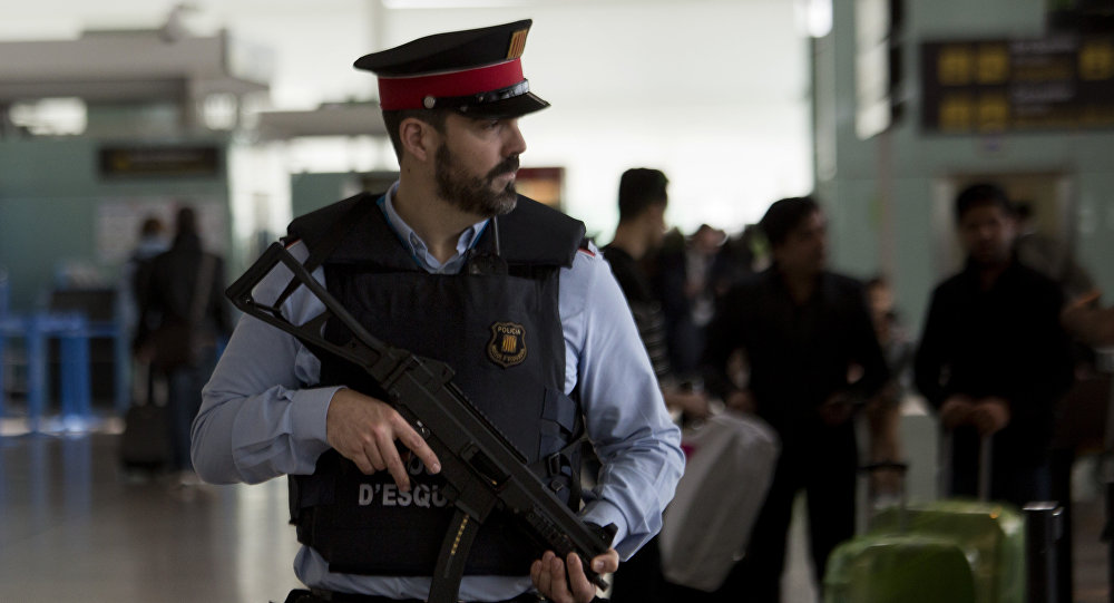 A police officer guards a terminal of the airport during tighter security measures in Barcelona, Spain, Tuesday, March 22, 2016
