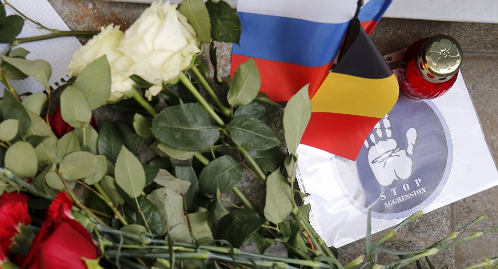 Flowers and a candle for the victims of Brussels attacks are placed in front of the Belgian embassy in Moscow, Russia, March 22, 2016