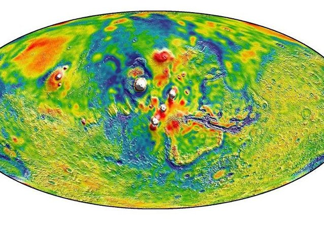 A Martian gravity map showing the Tharsis volcanoes and surrounding flexure. The white areas in the center are higher-gravity regions produced by the massive Tharsis volcanoes, and the surrounding blue areas are lower-gravity regions that may be cracks in the crust (lithosphere).