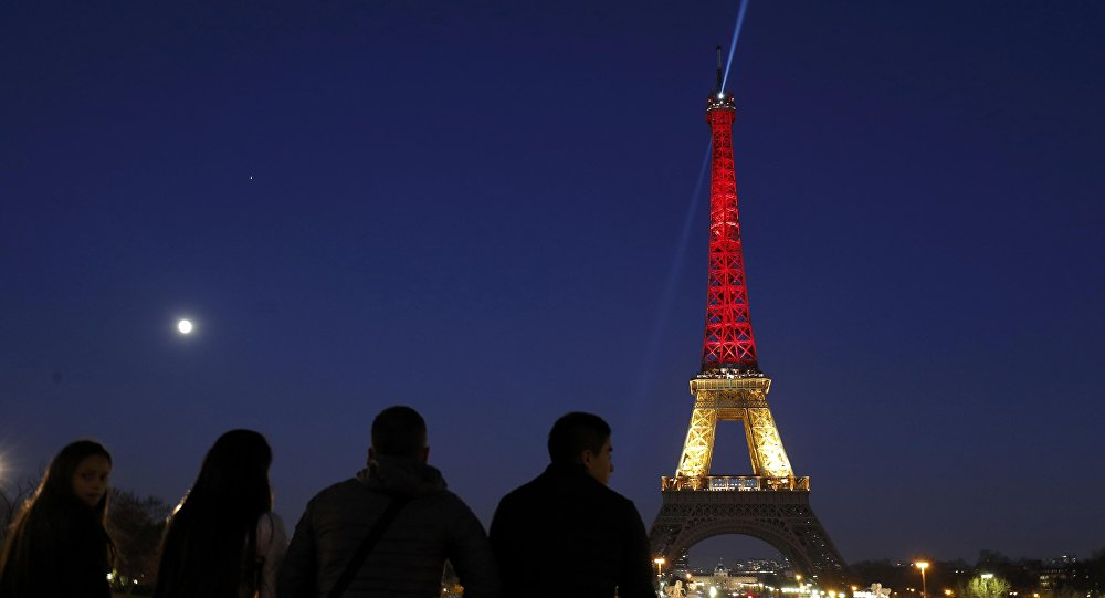 Eiffel Tower Lights Up in Colors of Belgium's Flag ...