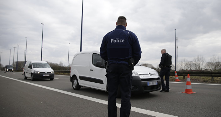 Belgian police officers check vehicles at the French-Belgian border, northern France, on March 22, 2016