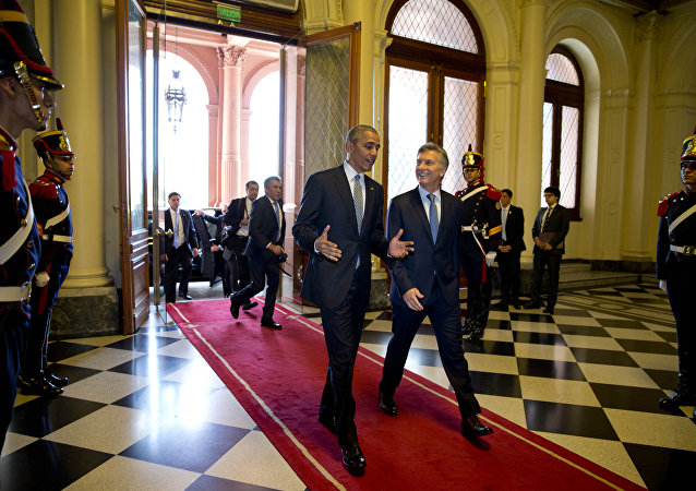 U.S. President Barack Obama and Argentina's President Mauricio Macri walk in the government house in Buenos Aires, Argentina, Wednesday, March 23, 2016
