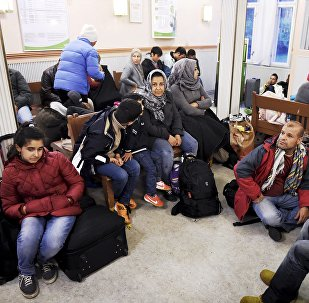 Iraqi refugees wait for a train to Helsinki at Kemi railway station in northwestern Finland
