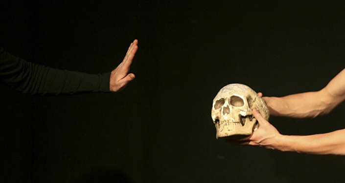 An actor performs during William Shakespeare's theatre play Hamlet at the Jerusalem Centre for the Performing Arts in this file photograph dated December 11, 2008.
