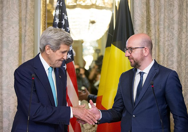 US Secretary of State John Kerry shakes hands with Belgian Prime Minister Charles Michel after delivering a joint statement at the Belgian Prime Minister's Residence in Brussels, Belgium, Friday, March 25, 2016.