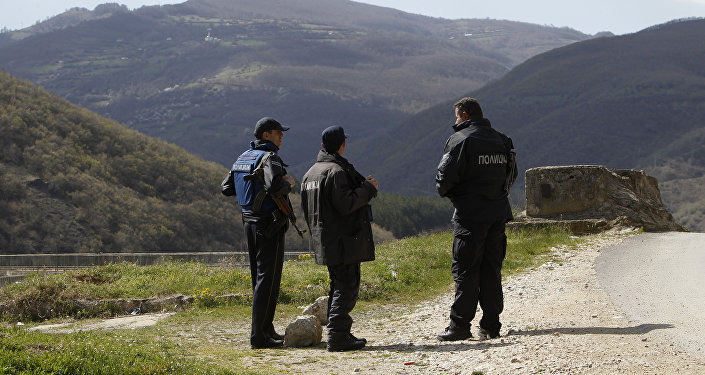 Police officers look towards the Macedonian mountain village of Gosince from a police check point set near the northern Macedonian border with Kosovo. (File)