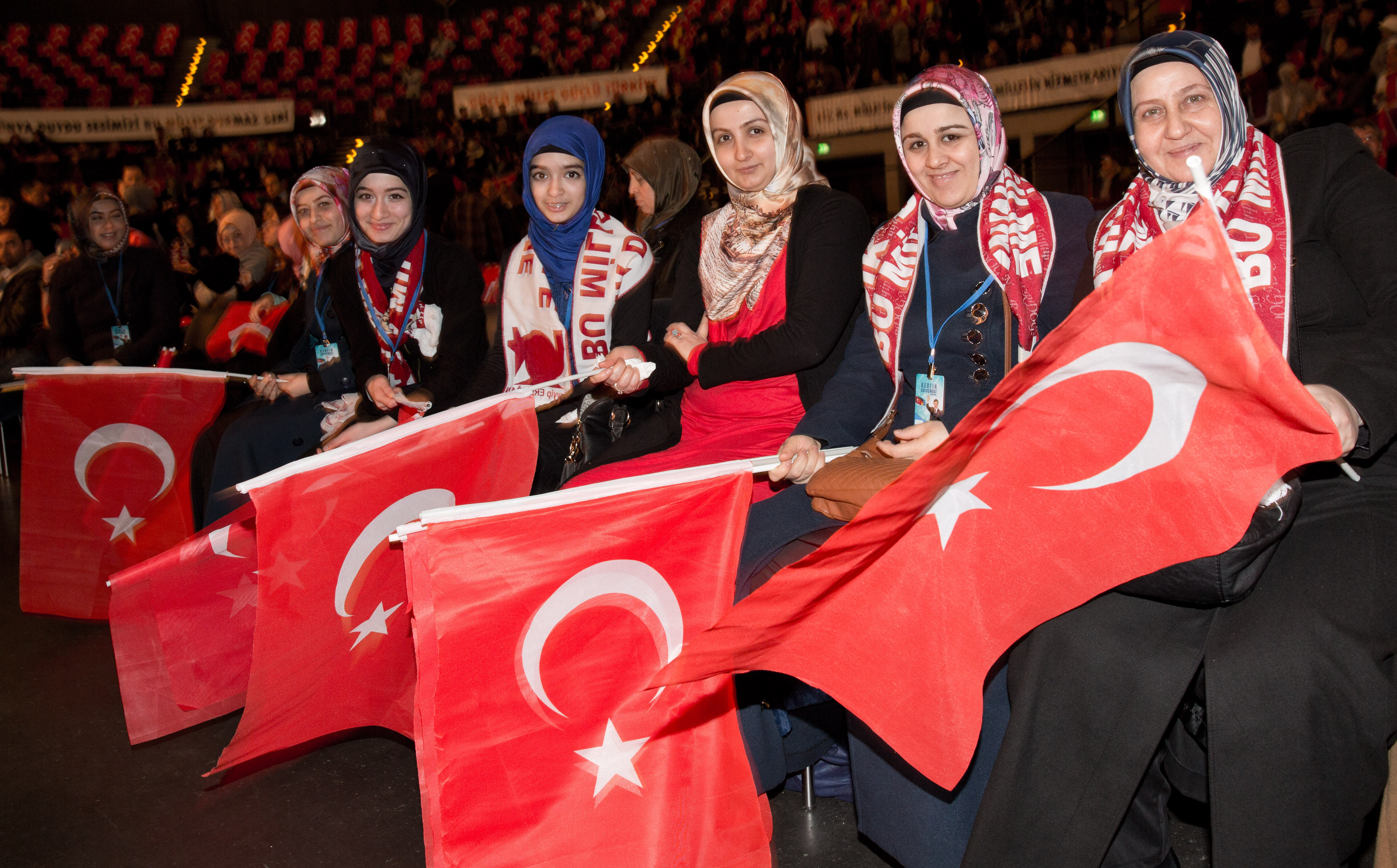 Members of Turkish community holding Turkish flags listen to a speech of Turkish Prime Minister in Tempodrom in Berlin during his state visit. (File)
