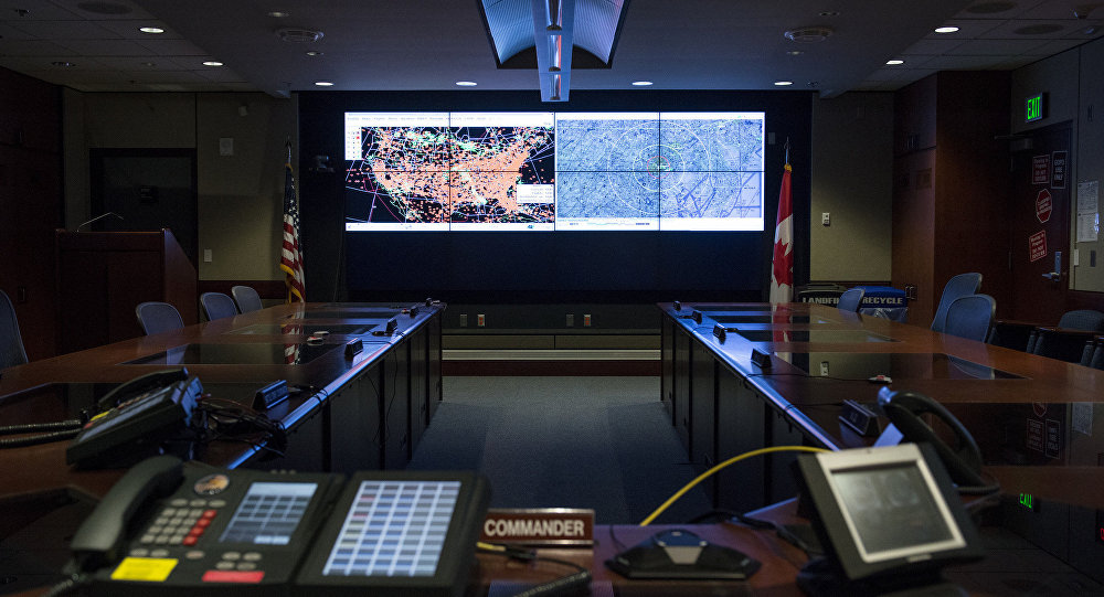 Two large screens light up the alternate command and control center in the Cheyenne Mountain Complex in Colorado