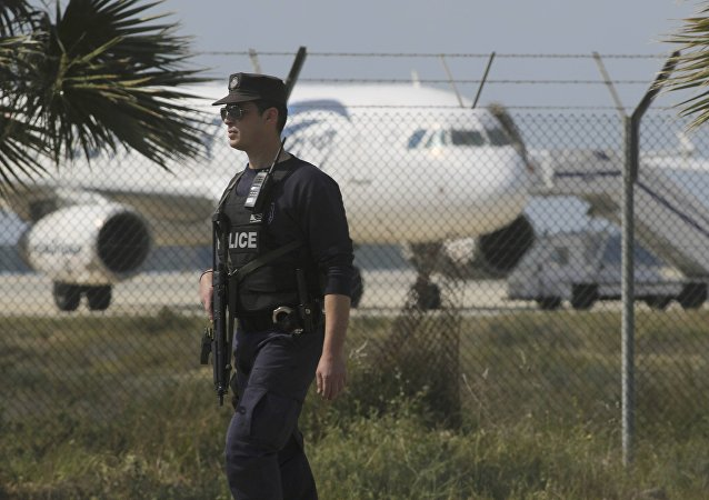 Police stand guard at Larnaca Airport near a hijacked Egyptair Airbus A320 , March 29, 2016