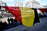 A Belgian flag reading Brussels my beauty, I am Brussels flutters as people gather at the makeshift memorial outside the stock exchange in Brussels on March 27, 2016 an area which has become an unofficial shrine to victims of the March 22, terror attacks.
