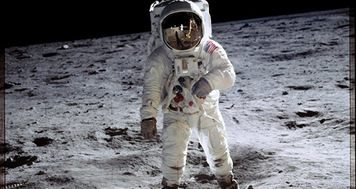 Astronaut Buzz Aldrin walks on the surface of the moon near the leg of the lunar module Eagle during the Apollo 11 mission.