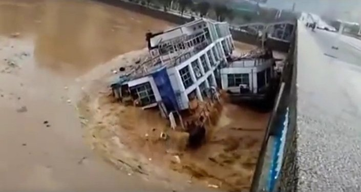 Abandoned barges crash into bridge in China after heavy rainfall