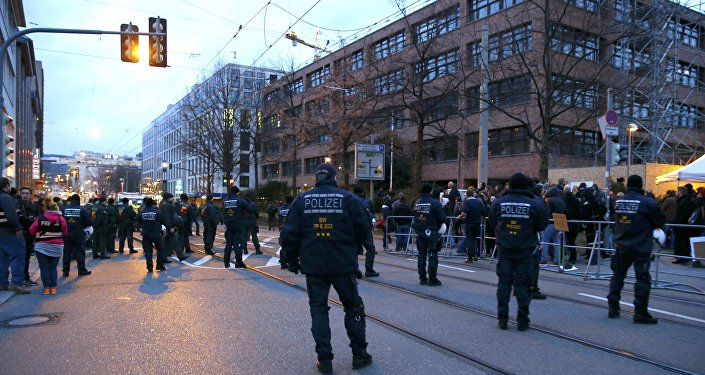 Police stand guard outside the building of the anti-immigration Alternative for Germany (AFD) party