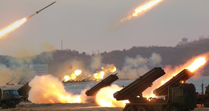 Multiple rocket launchers are seen being fired during a military drill at an unknown location, in this undated photo released by North Korea's Korean Central News Agency (KCNA) on March 25, 2016