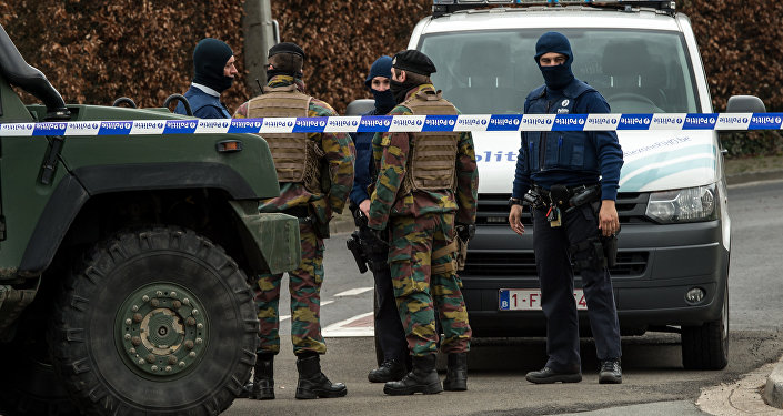 Belgian police and servicemen block access to the closed hotel and restaurant Villa Marquette on March 31, 2016, in Courtrai, during an operation in connection with a foiled attack plot in France, whose main suspect was charged this week with membership of a terrorist organisation