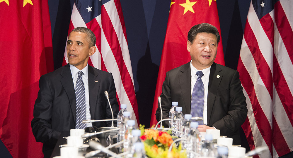 US President Barack Obama (L) sits with Chinese President Xi Jinxing during a bilateral meeting ahead of the opening of the UN conference on climate change COP21 (File)