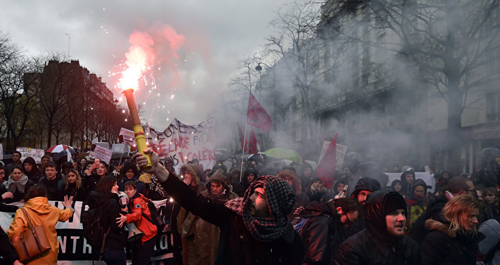 Protesters demonstrate during a demonstration against labour law reforms in the French capital Paris on March 31, 2016