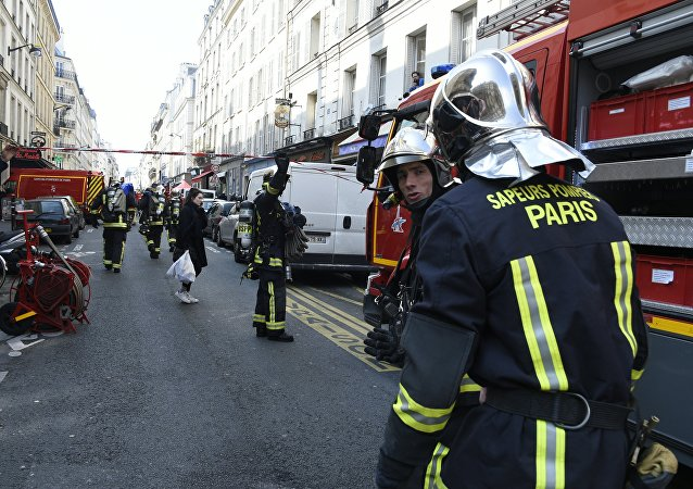 Firefighters intervene in rue du Cherche-Midi in Paris' 6th district near the scene where an appartment building exploded on April 1, 2016 in Paris