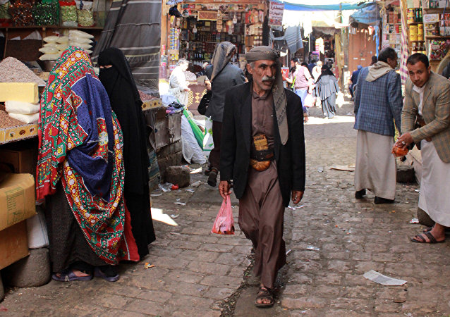 Yemenis shop at a market in the old city of the capital Sanaa (File)