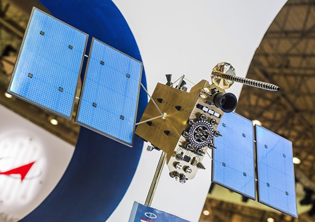 A file photo showing a model of the Glonass-K Russian spacecraft at the Information Satellite Systems stand during the 2015 Dubai Airshow international exhibition.