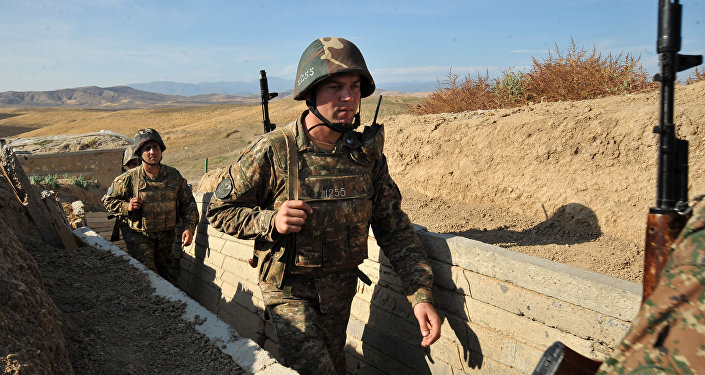 Armenian soldiers of the self-proclaimed republic of Nagorno-Karabakh walking in trenches at the frontline on the border with Azerbaijan.
