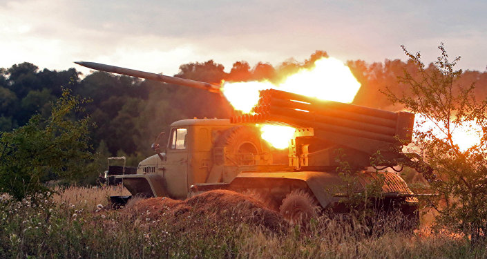 A BM-21 Grad multiple rocket launcher system fires during gun practice of the Baltic Fleet Coast Artillery Corps at the Pavenkovo range, Kaliningrad Region.