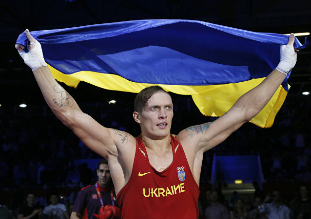 Oleksandr Usyk of the Ukraine waves the Ukrainian national flag