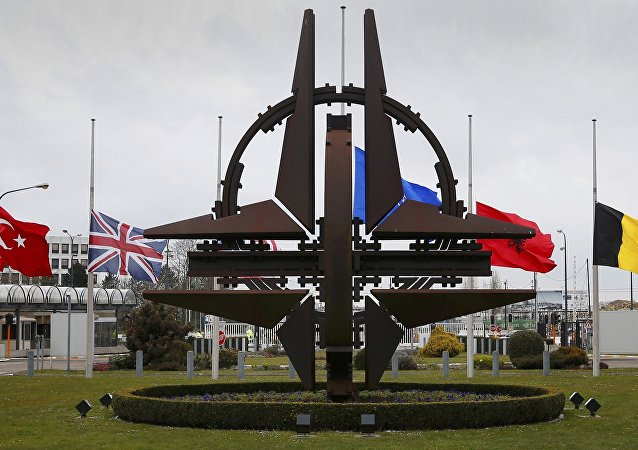 Flags fly at half mast at NATO headquarters in Brussels, March 23, 2016.