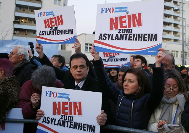 Protesters hold up banners reading No refugee home during a demonstration by the Austrian Freedom Party (FPOe) in Vienna, Austria, March 14, 2016.